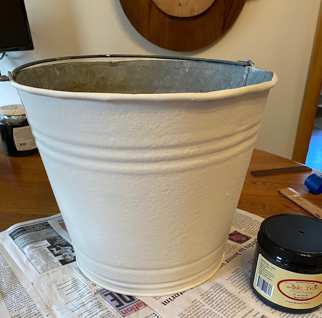 Photo of a metal bucket painted white