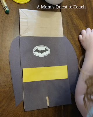 Batman paper bag puppet with all pieces but mask attached