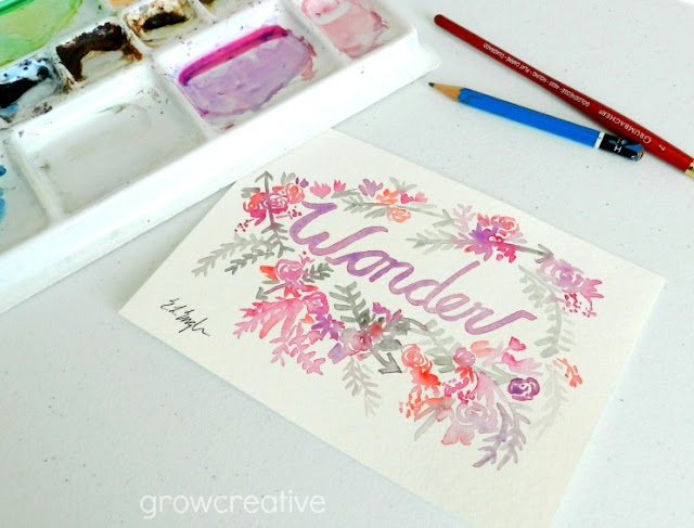 Wonder- watercolor lettering artwork with flowers and arrows: growcreative