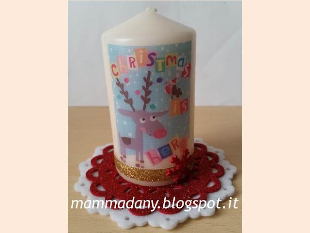 candela con la renna di natale