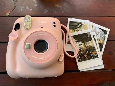 Blush pink Instax mini 11 with Instax prints