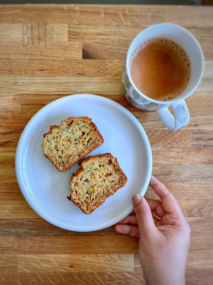 two slices of Zucchini Quick Bread with honey and buttermilk served with chai