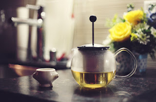 Green tea in teapot