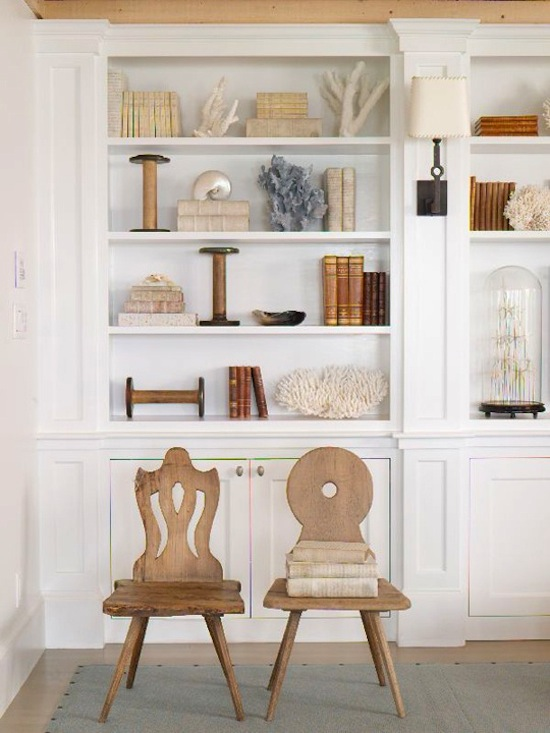 bookcase styling, neutral objects, coral, books display