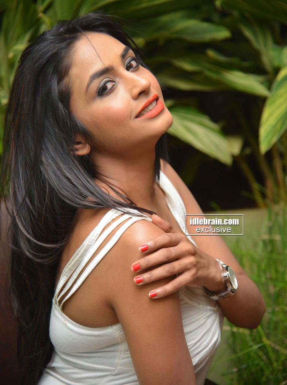 Pooja Sri in a Deep Neck Sleeveless short dress spicy Pics