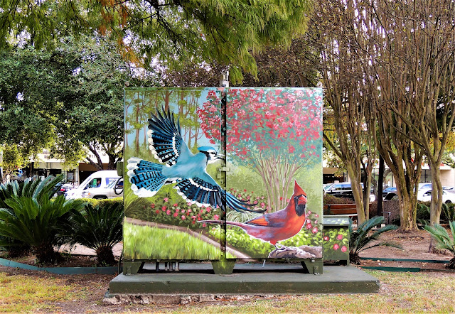 Painted blue jay and cardinal on utility box at Bellaire Transit Center