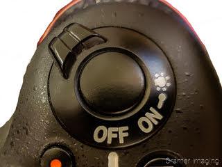 Photograph of up close of a camera shutter button