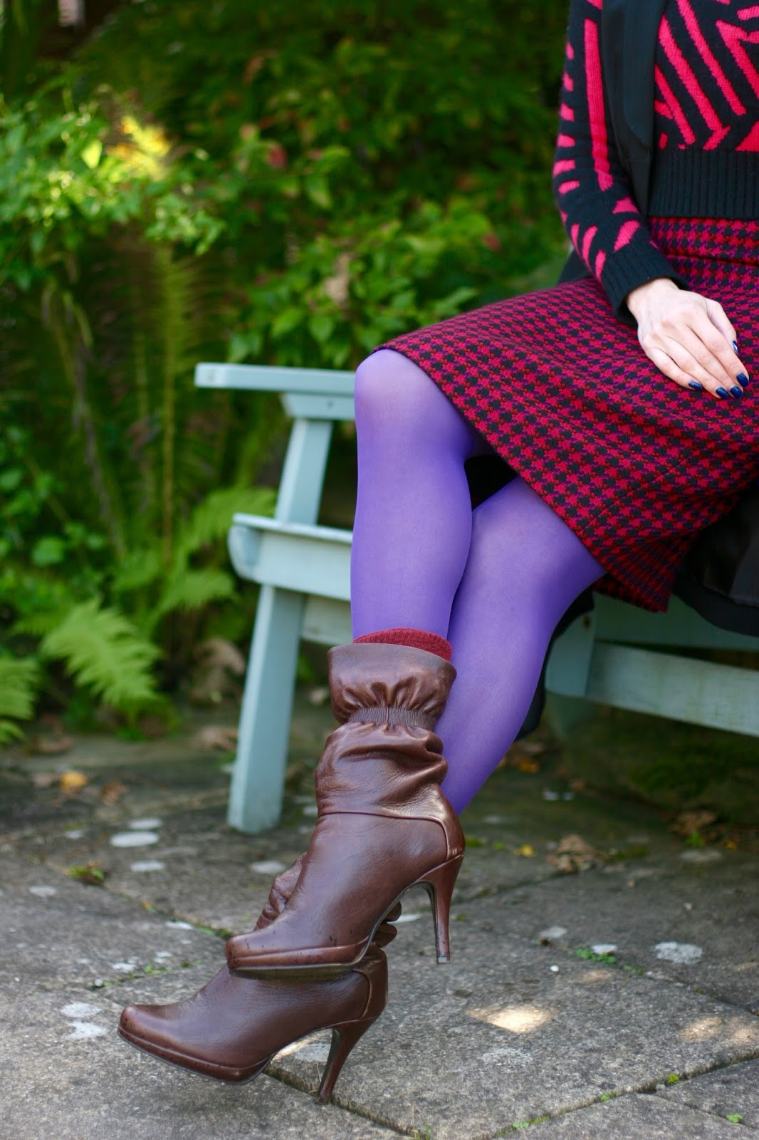 Vintage houndstooth pencil skirt and purple tights.