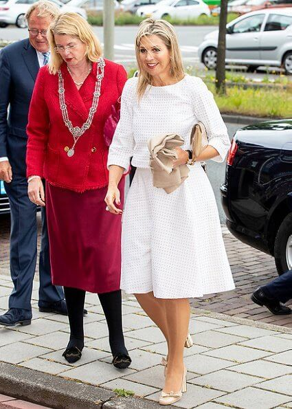 Queen Maxima wore a white jumpsuit by Natan. Money Wise platform aims to enhance financial literacy of people