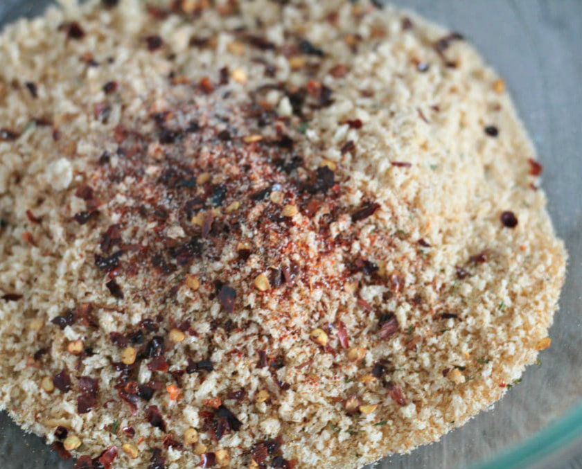 Mix breadcrumbs with chili flakes
