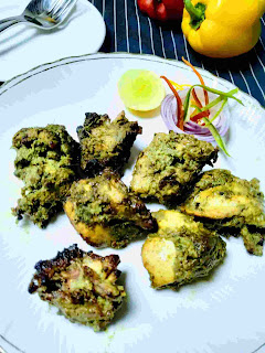 Serving hariyali kabab in a garnished plate