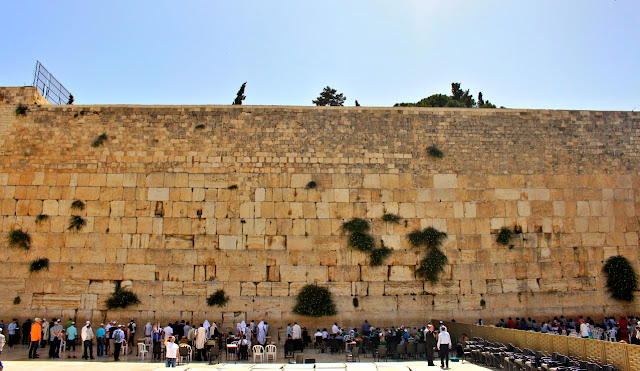 people praying at the Wailing Wall in Jerusalem