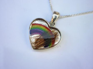 Sterling silver hair and rainbow pendant