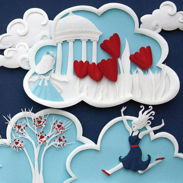 paper sculpture scenes of girls in dresses within clouds containing trees and red hearts