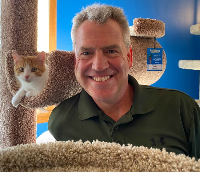 Owner, Darryl Michaelson, from Purrniture with cat