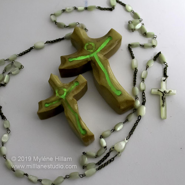 Wooden crosses with glow in the dark resin representing Jesus.