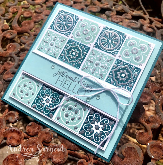 A card featuring a deep teal blue-green, Pretty Peacock, with 2-step layered stamping and heat embossing.