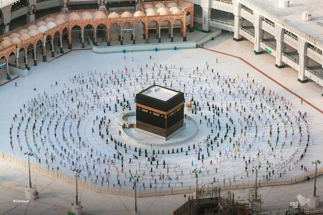 The pilgrims around the Kaaba in Masjid Al-Haram