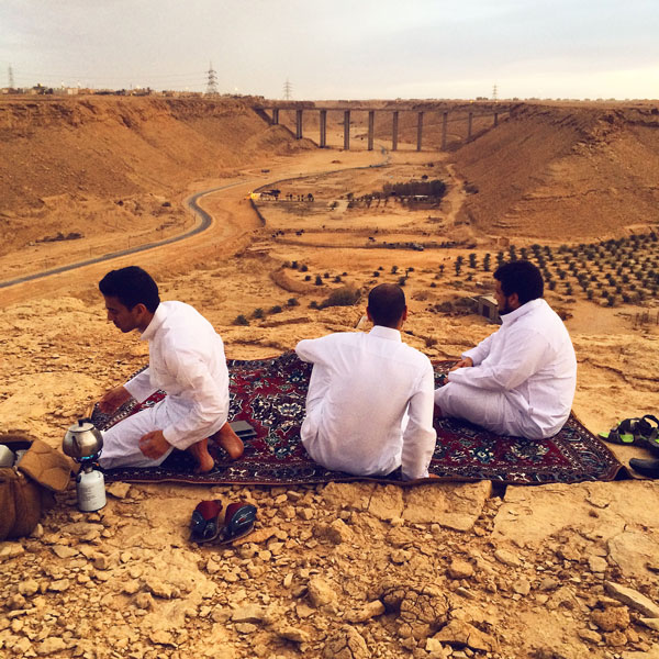 men desert picnic riyadh saudi arabia photo