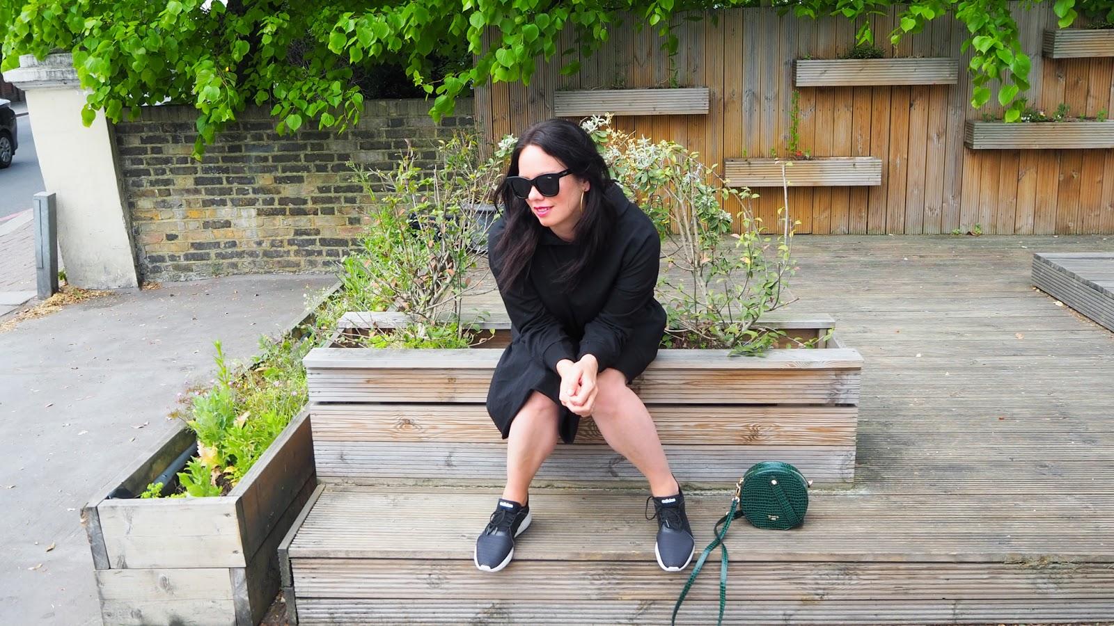 Black hoodie sweat dress with asymmetric ruffle hem