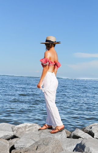 off the shoulder crop top with white beach pants