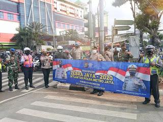 Satlantas Polrestro Jaktim Sosialisasi Tertib Berkendara dan Penerapan Prokes Bagi Pengguna Jalan