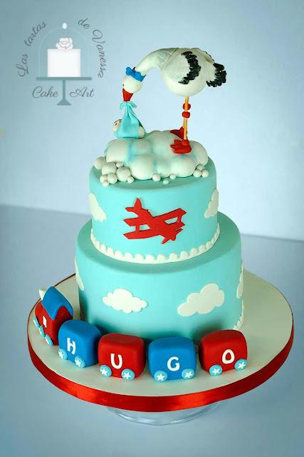tarta de fondant bautizo cigüeña, tren y avión
