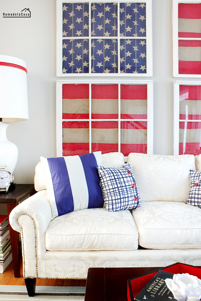 old windows decorated with American flag to celebrate fourth of July