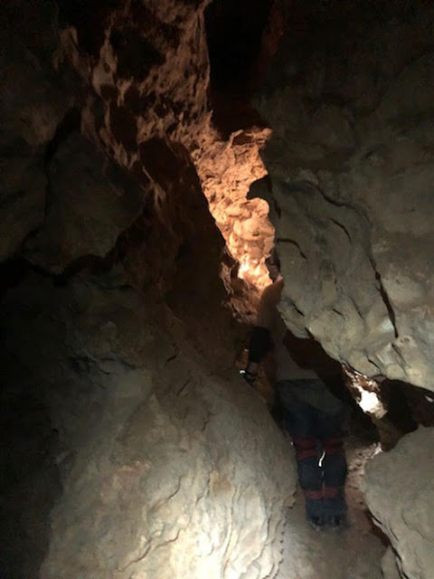 Scrambling through one of the sections where we could stand up the Robber Baron Cave! (Source: Palmia Observatory)
