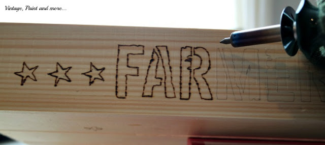 Using woodburning tool to outline stencil lines