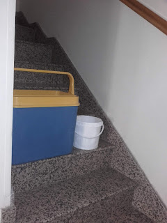 containers for catching water from leaking roof