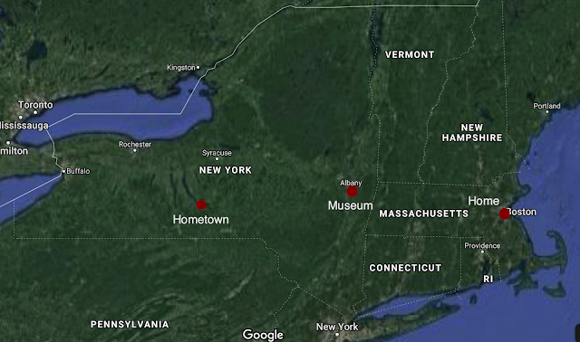 A map showing NY and MA, with Ithaca, Albany, and Boston noted.