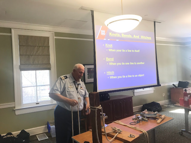 AUX John Fisher shows the difference between a knot, hitch and bend to the class and demonstrates for them.
