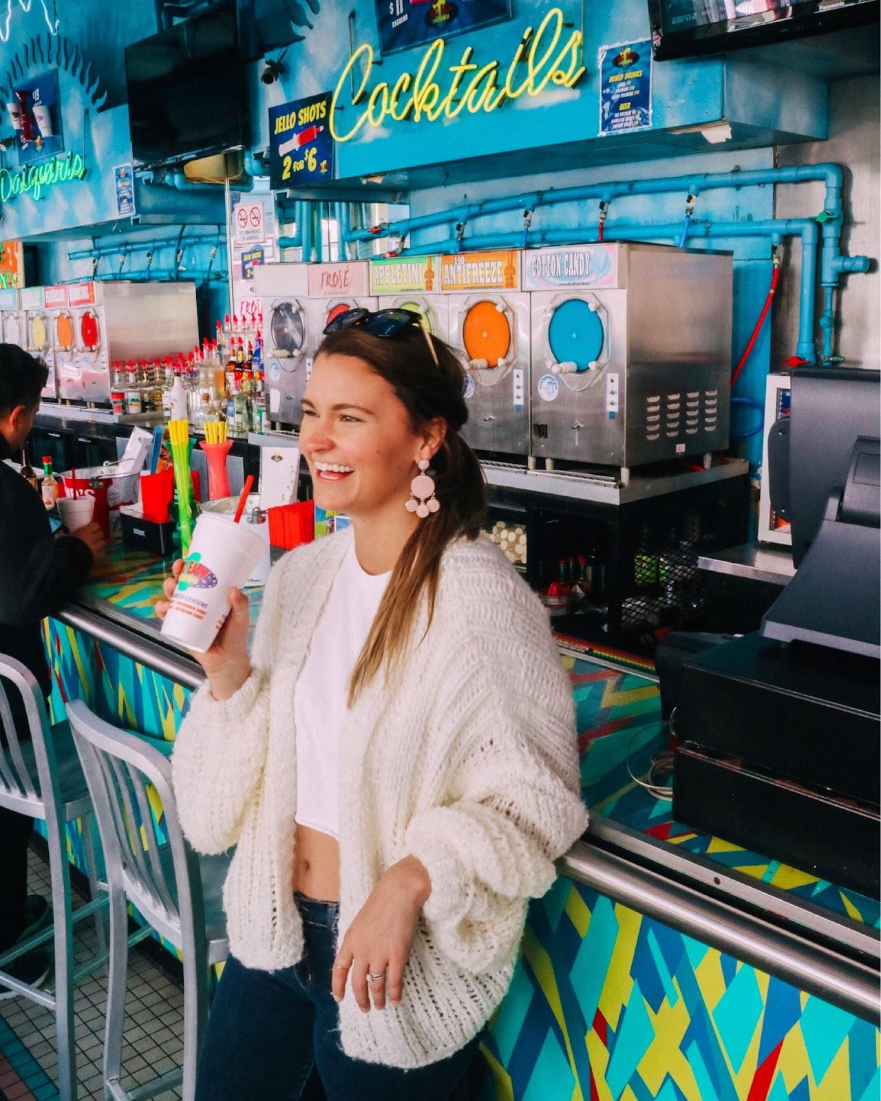 Travel blogger enjoying frozen daiquiris from Big Easy Daiquiris in New Orleans