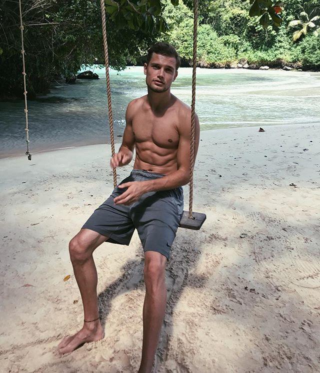 handsome-shirtless-fit-dude-enjoying-summer-vacation-beach-nature-swing