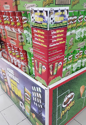 "The full Pringles display includes the message ""Make football more fun."""