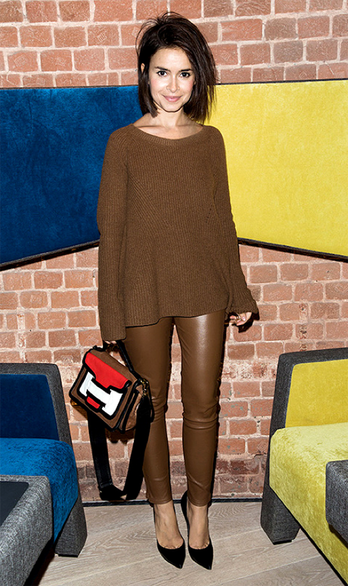 Miroslava Duma wears monochrome style with an all brown look in a sweater and leather leggings and a colour blocked bag