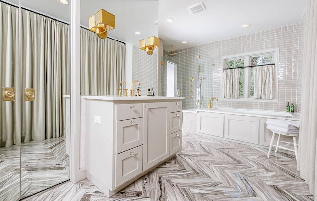 beautiful herringbone tile floor for luxury bathroom
