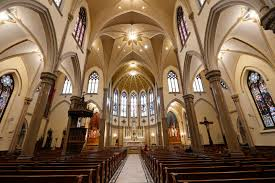 Image of the inside of a church from Boston Globe