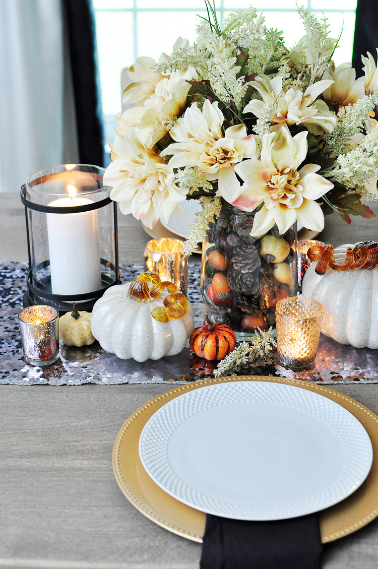 White neutral fall decor centerpiece tablescape with mercury glass candles, pumpkins, pinecones and acorns. | #falldecor #diningroomideas #diningroomdecorating #monicawantsit #centerpieces #falldecorideas