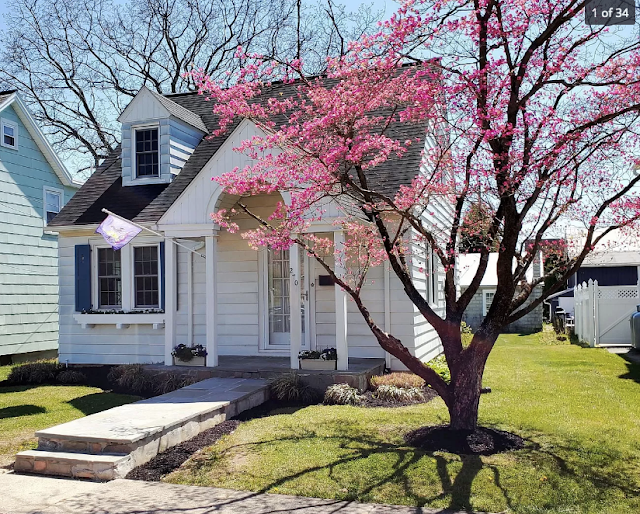color photo of small white cape style house with peak roof porch  and small dormer Sears Lorain • 270 Broad Street, Landisville, Pennsylvania