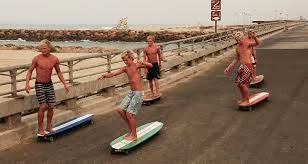Hamborg Familt riding Hamboards in Huntington Beach, California