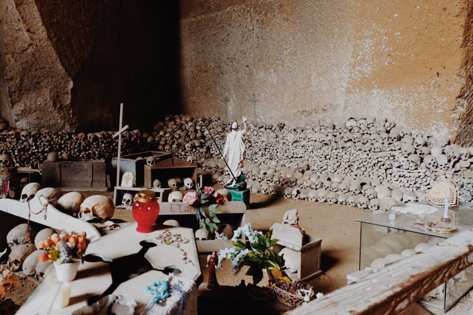 Skulls and tokens in the Cimitero Delle Fontanelle