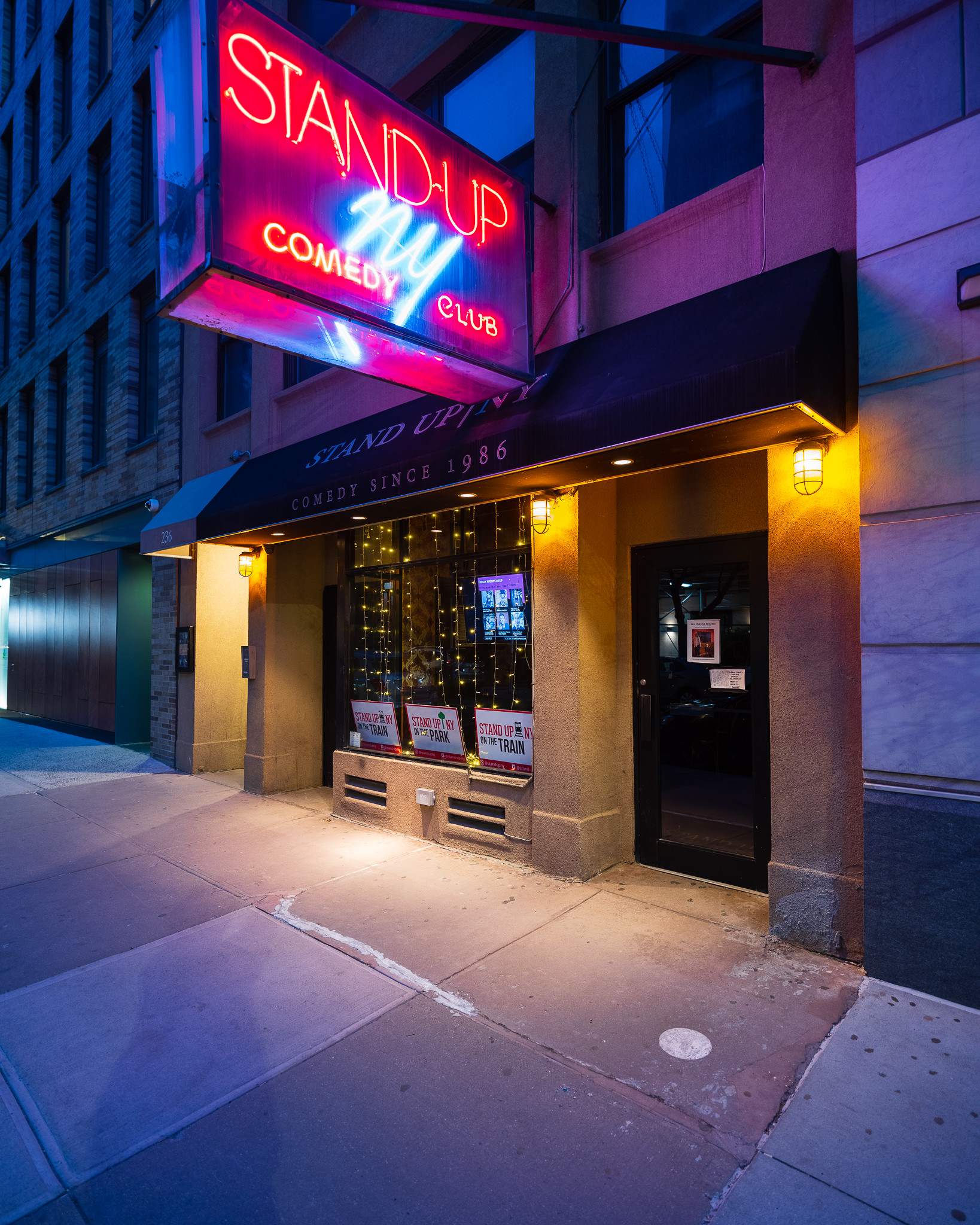 a photo of a new york comedy club at night