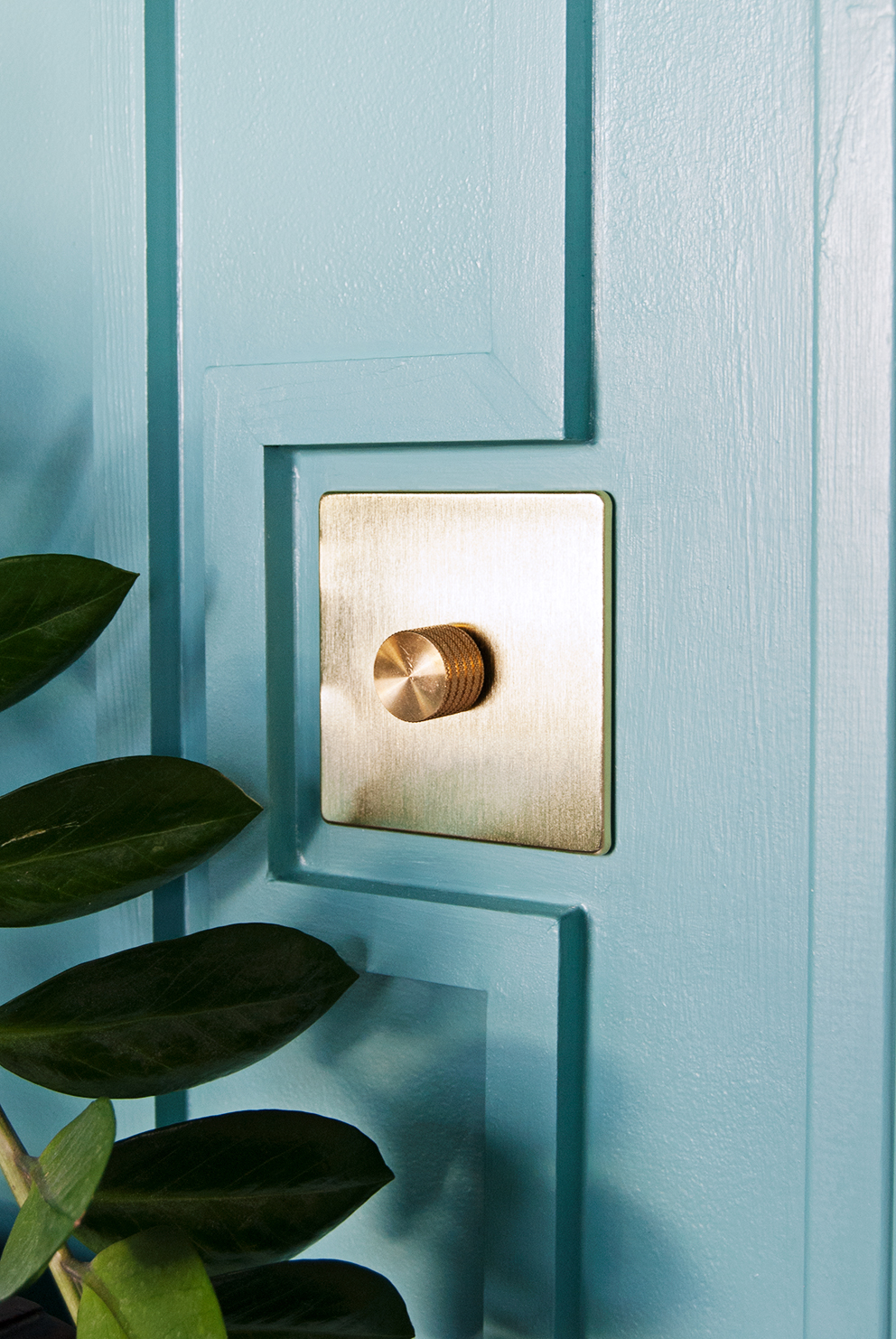 Family TV Room Reveal - French For Pineapple Blog - Decorative Wall Moulding with Brass Light Switch