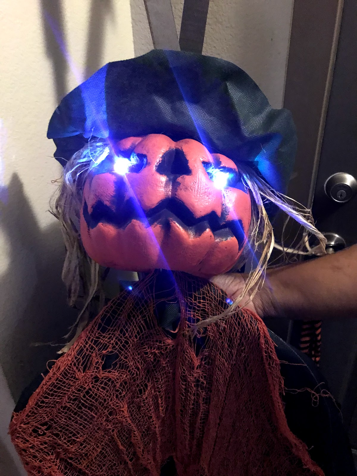 Image: Tangie Bell decorating her front entry way with Halloween glowing in the dark Pumpkin heads. Seen first on Bits and Babbles Blog