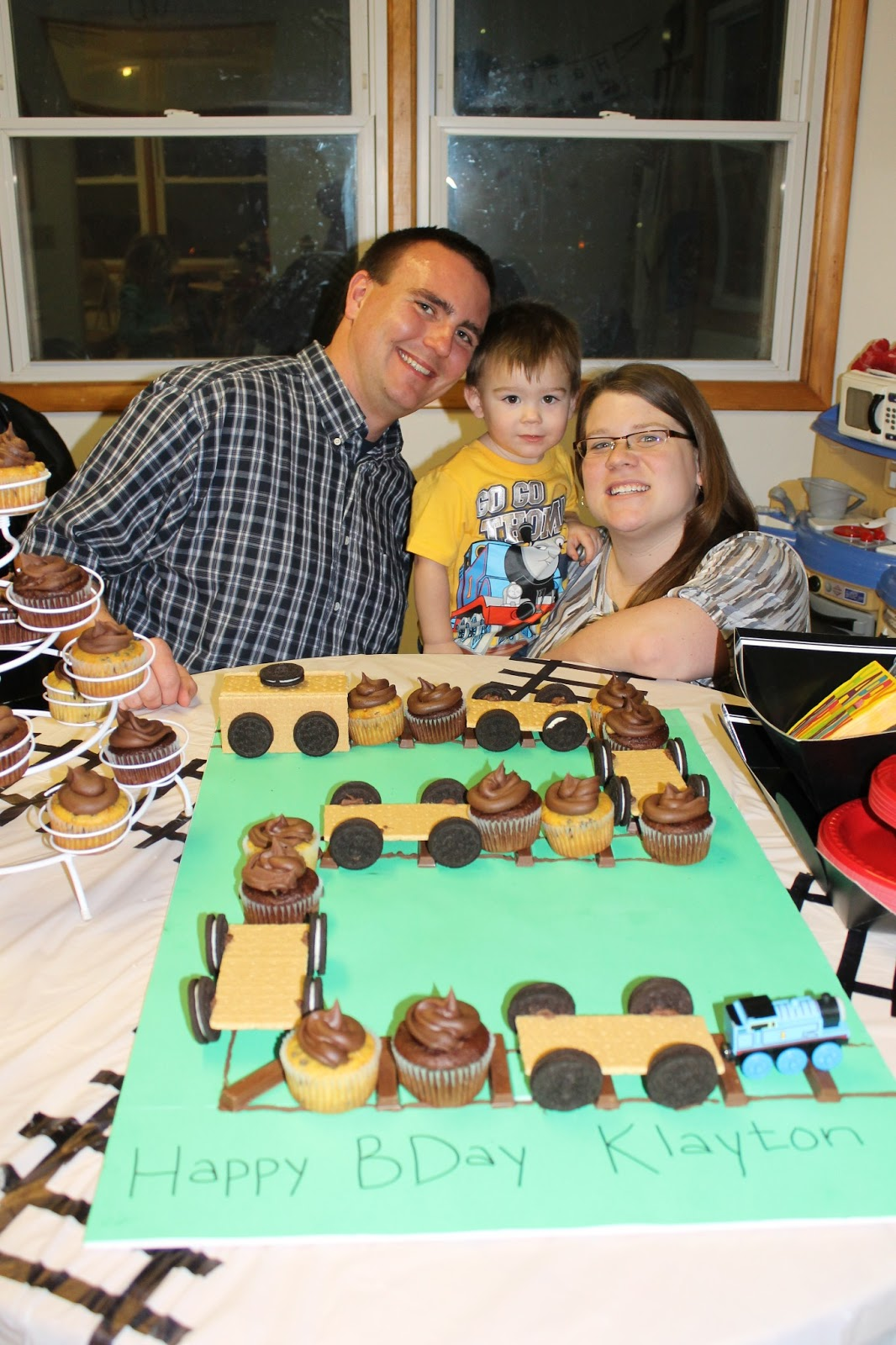 My Farmer LP And I Next To His Train Cupcakes Made A Railroad Track Out Of Kit Kats Frosting In The Shape 2