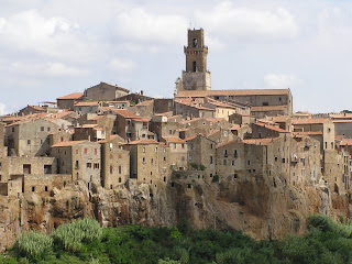 Pitigliano in Tuscany, where Zuccarelli was born, appears to be carved out of the rock on which it sits