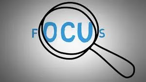 Focus written with microscope on it