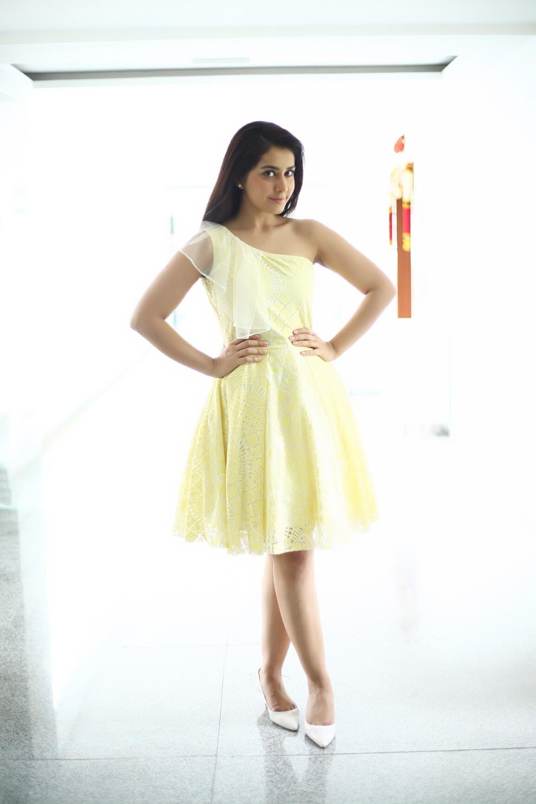 Tollywood Actress Rashi Khanna Beautiful Photoshoot In Yellow Mini Skirt
